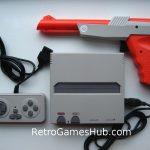 Retro NES console and zapper gun